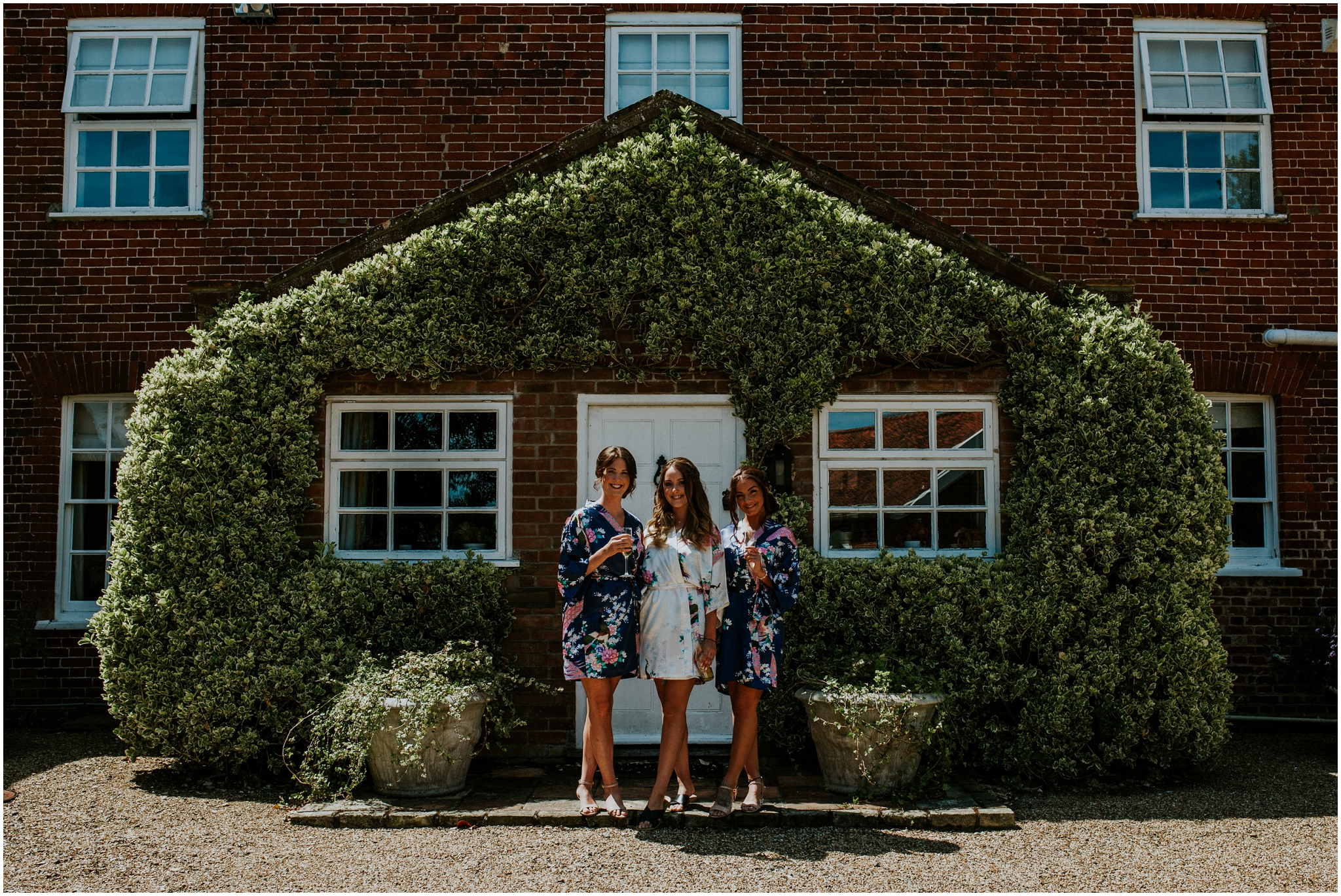 bride and bridesmaids wearing dressing gowns at the barn at woodlands norfolk