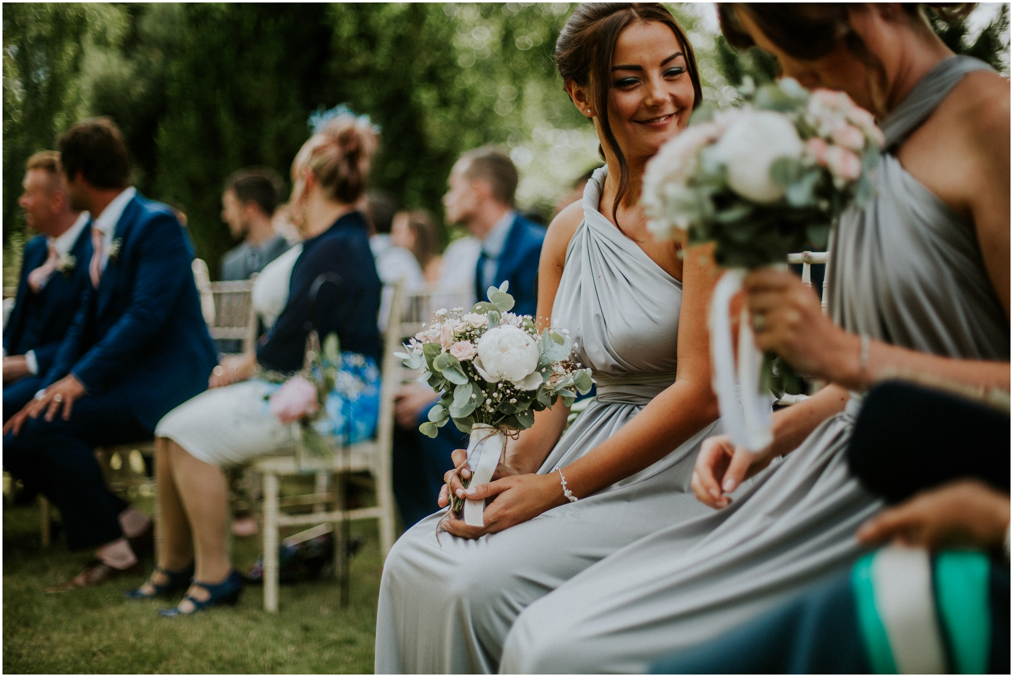 bridesmaid smiling outdoor wedding ceremony