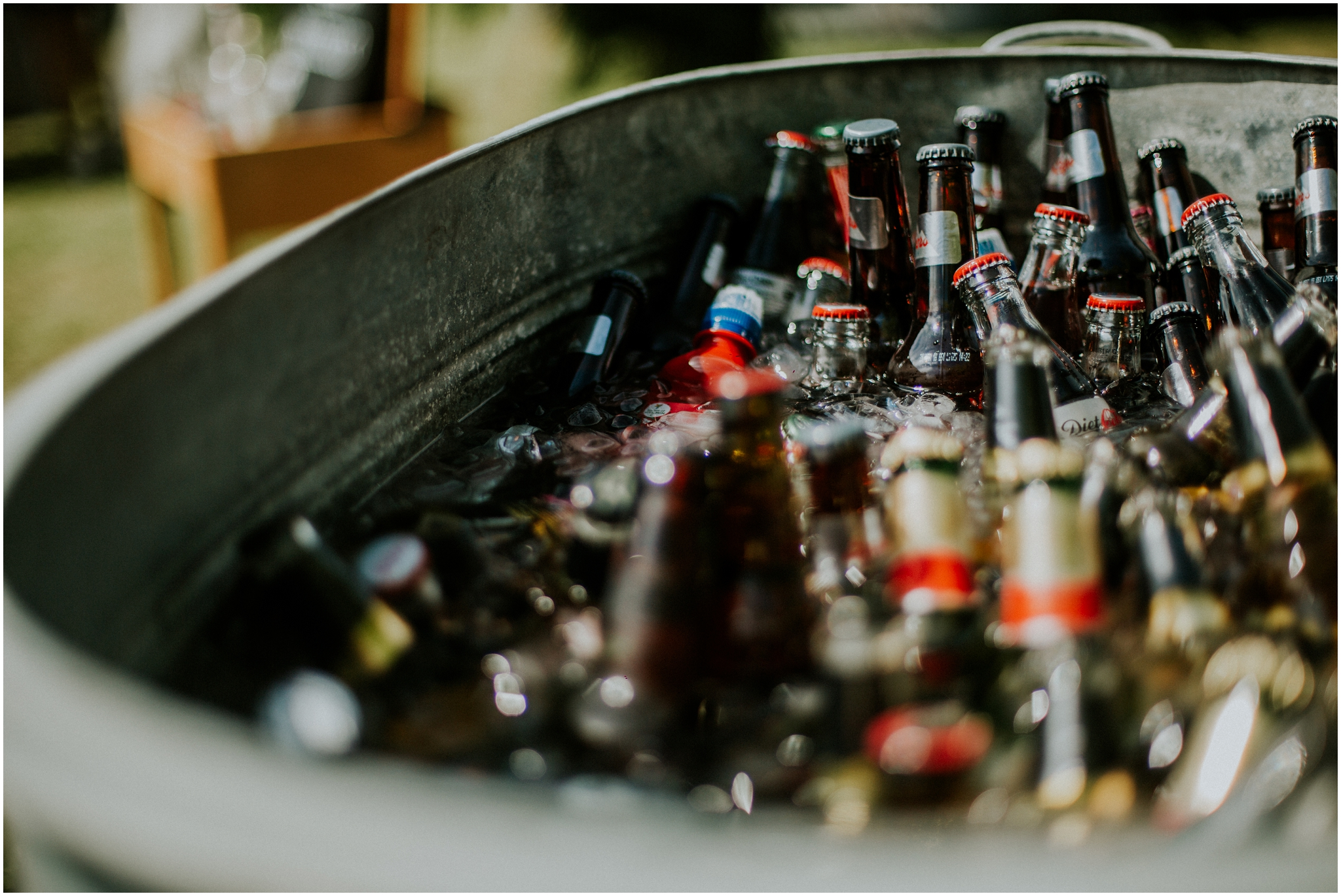 beers in an ice bucket outdoor wedding