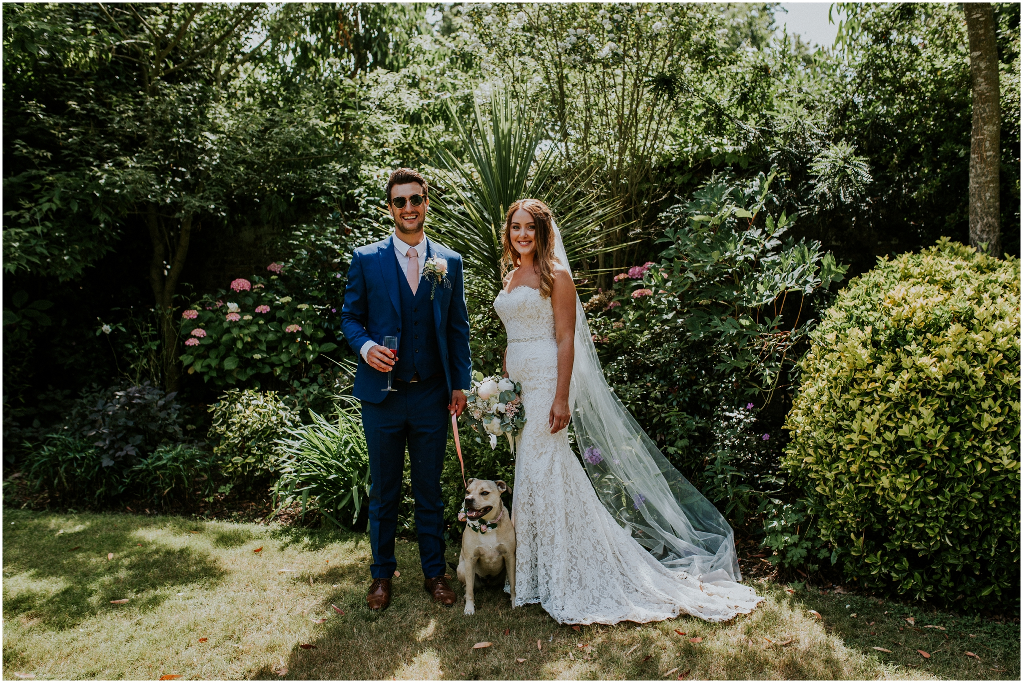 bride and groom with thier dog