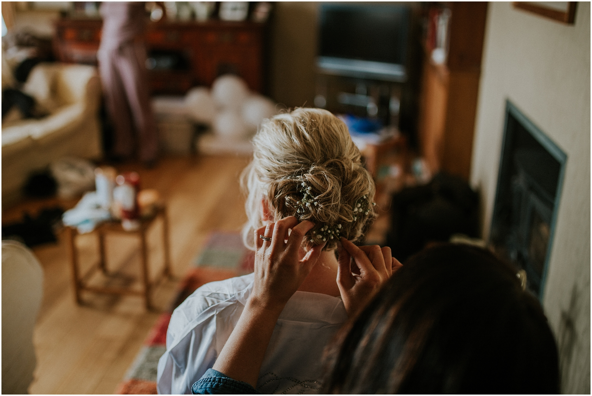 bride getting finishing touches to hair