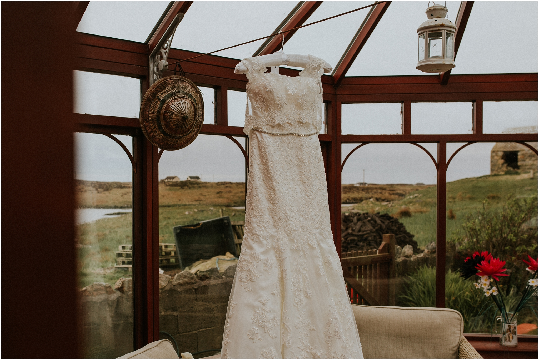 wedding dress hanging in brides conservatory isle of benbecula