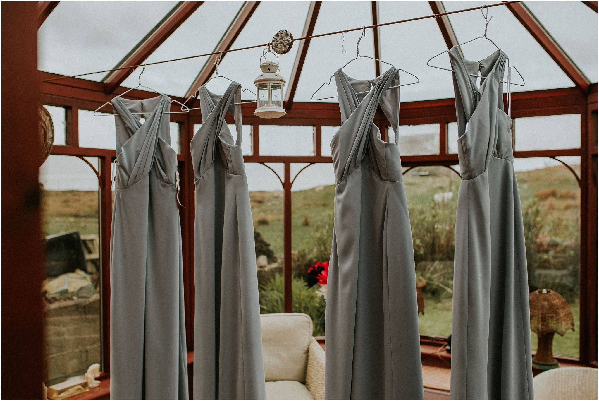 bridesmaids dresses hanging in conservatory benbecula wedding