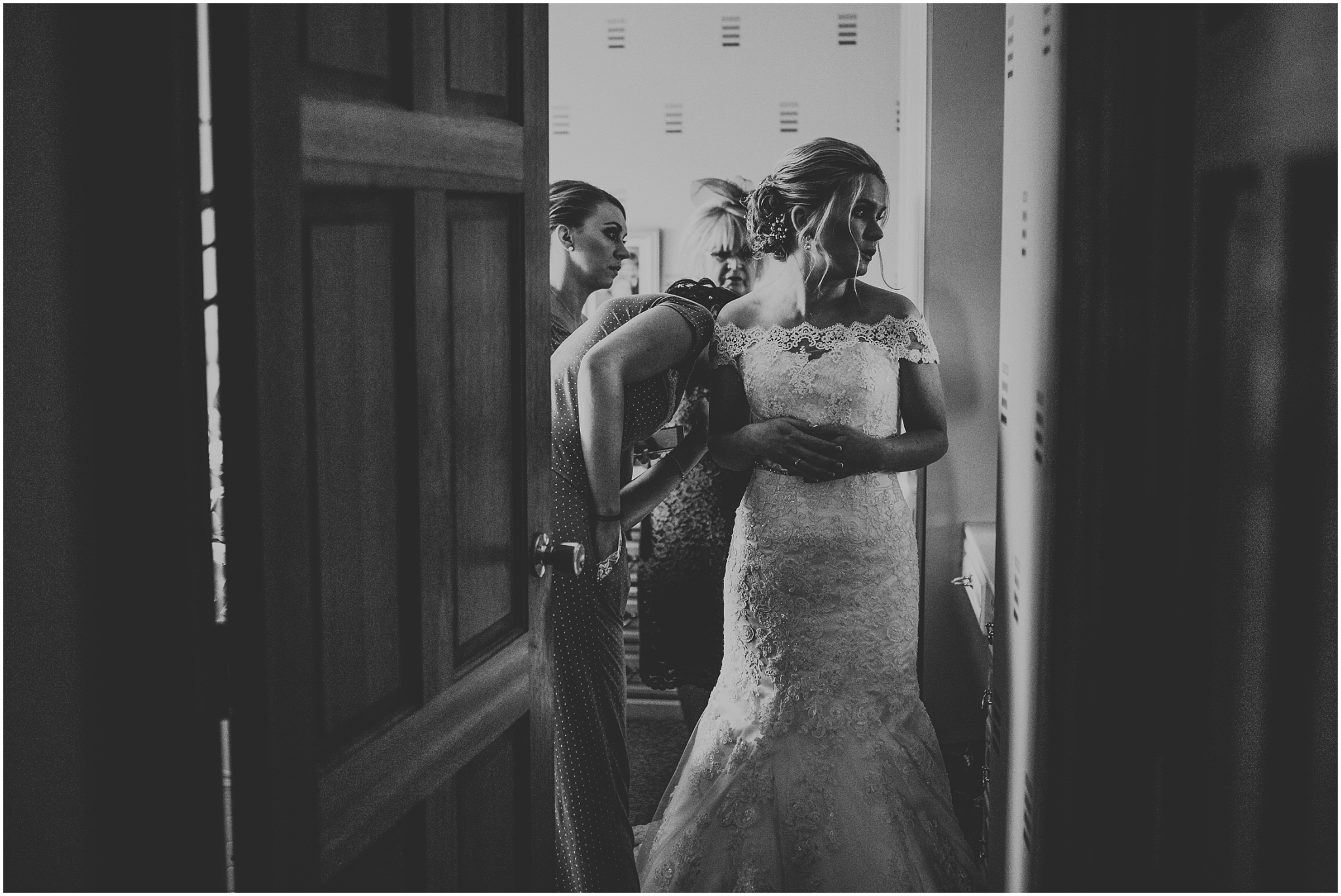 bride in doorway getting ready