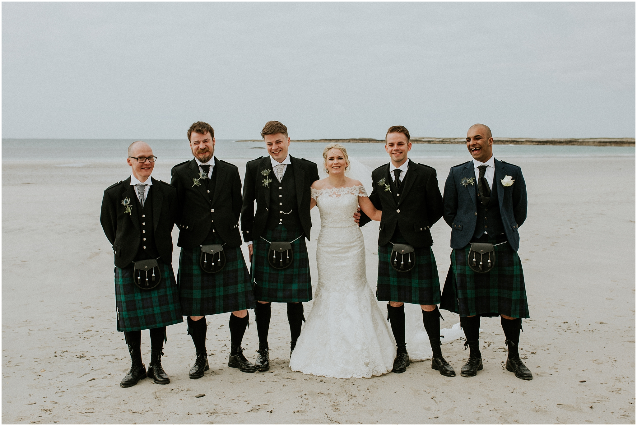 bride with groom and groomsmen