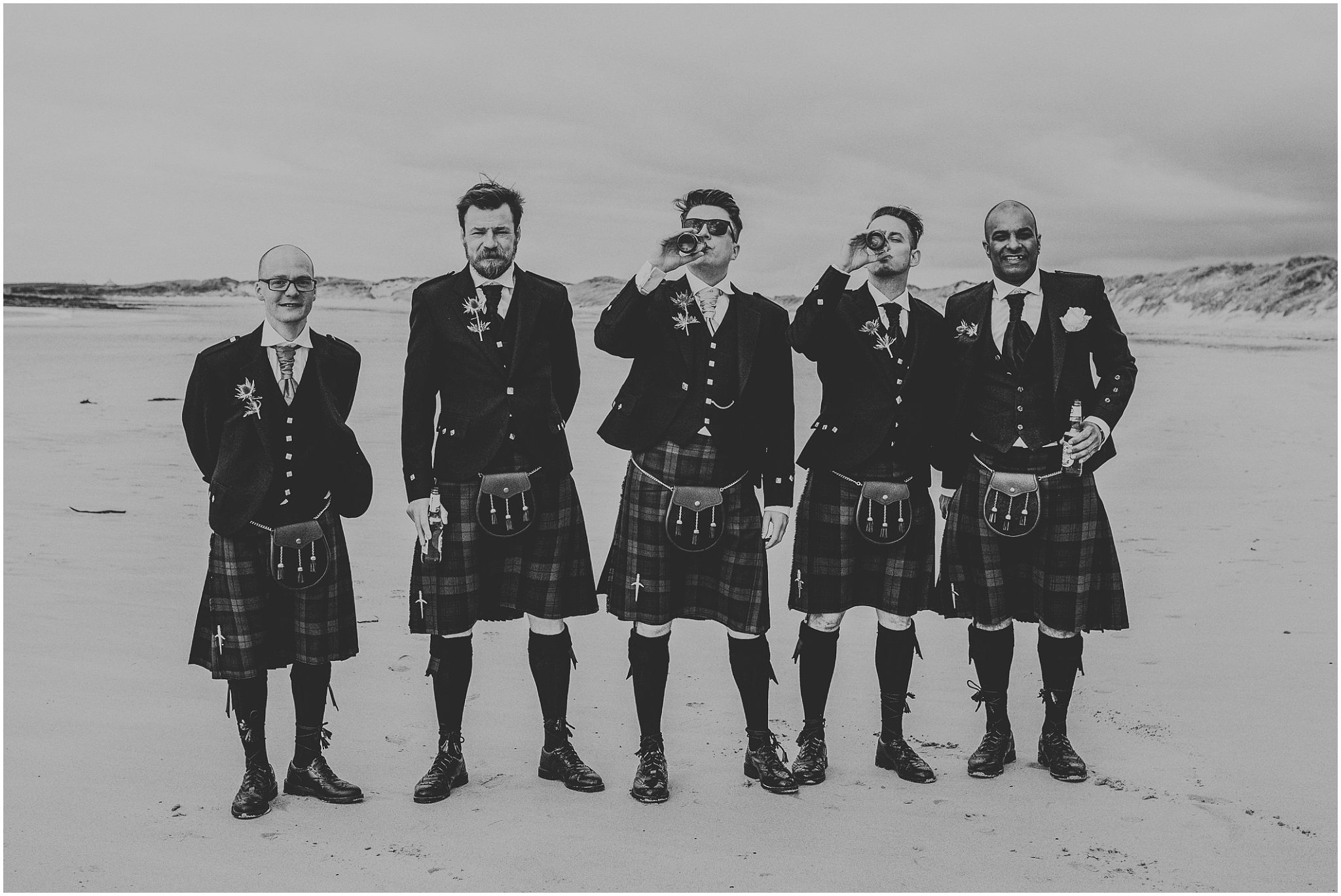 groomsmen drinking beer on the beach culla bay benbecula wedding
