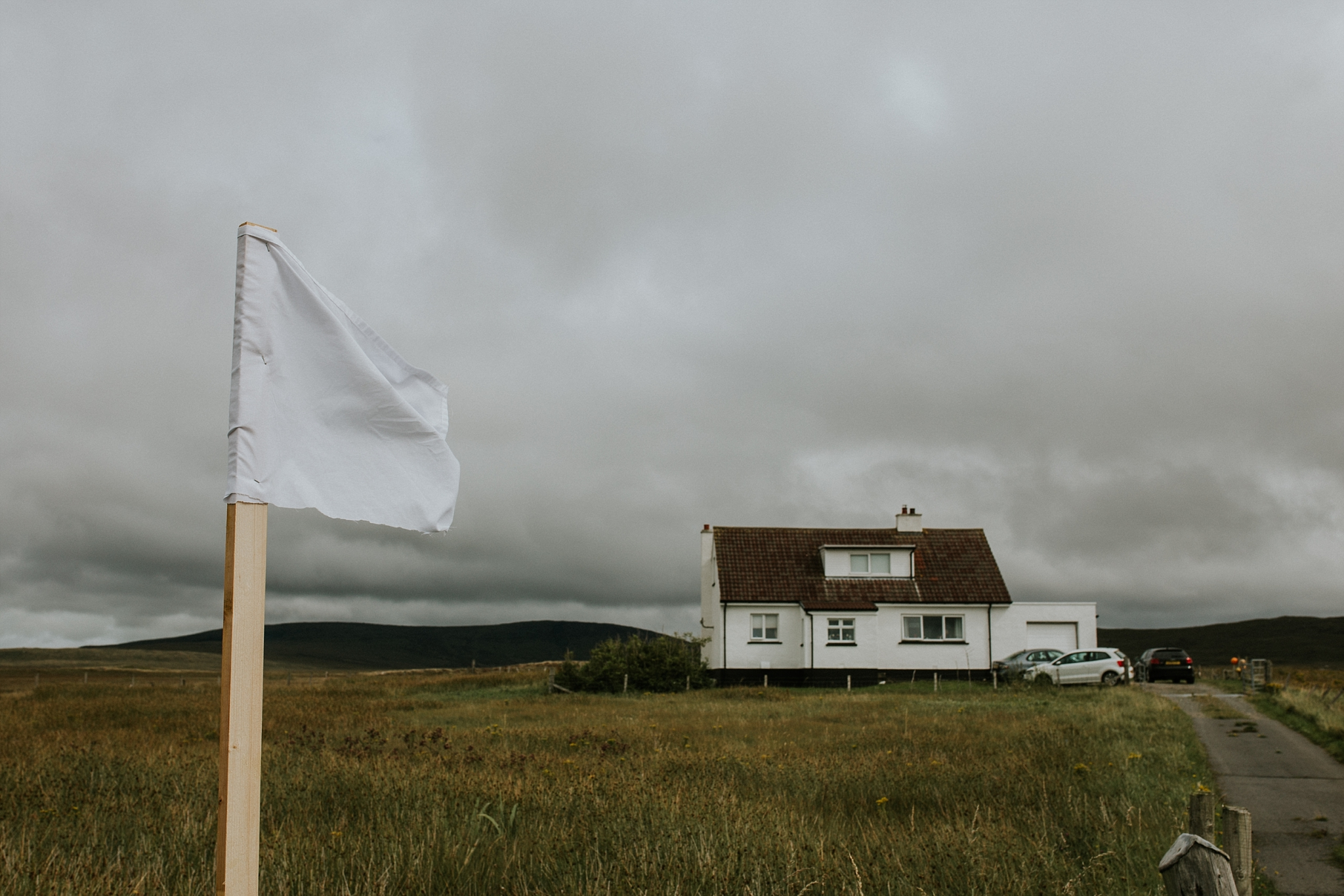 White flag outside house in North Uist, Wedding Day