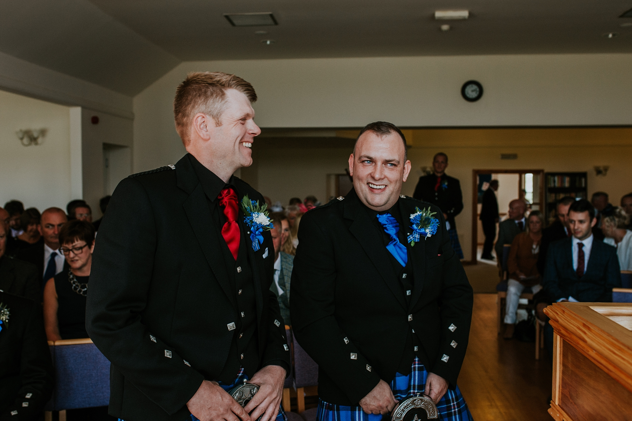 Groom and best man laughing in the church, Carnish, North Uist