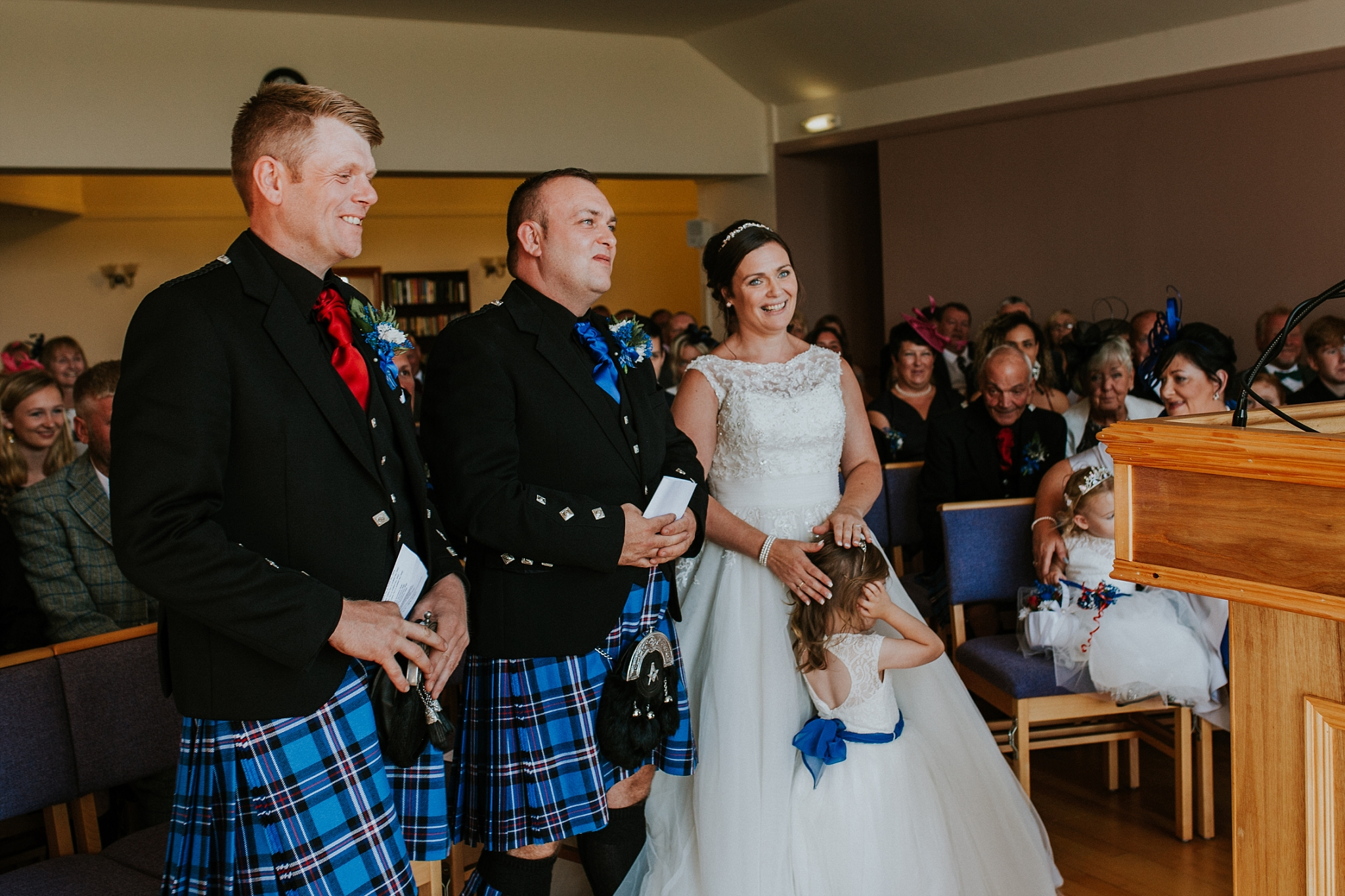 Bride, Groom and Best man laughing in Carnish Free Church