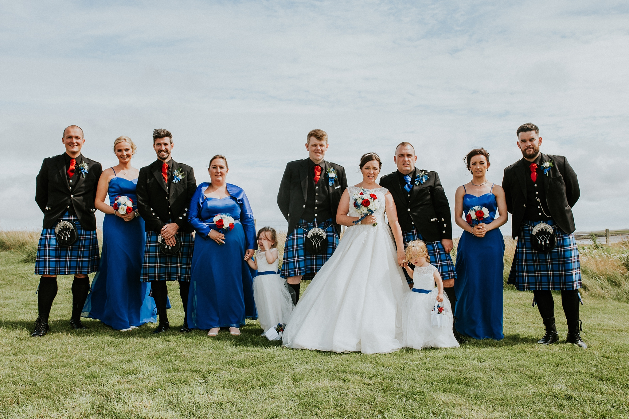 Bridal party group photo outside Carnish Free Church, North Uist