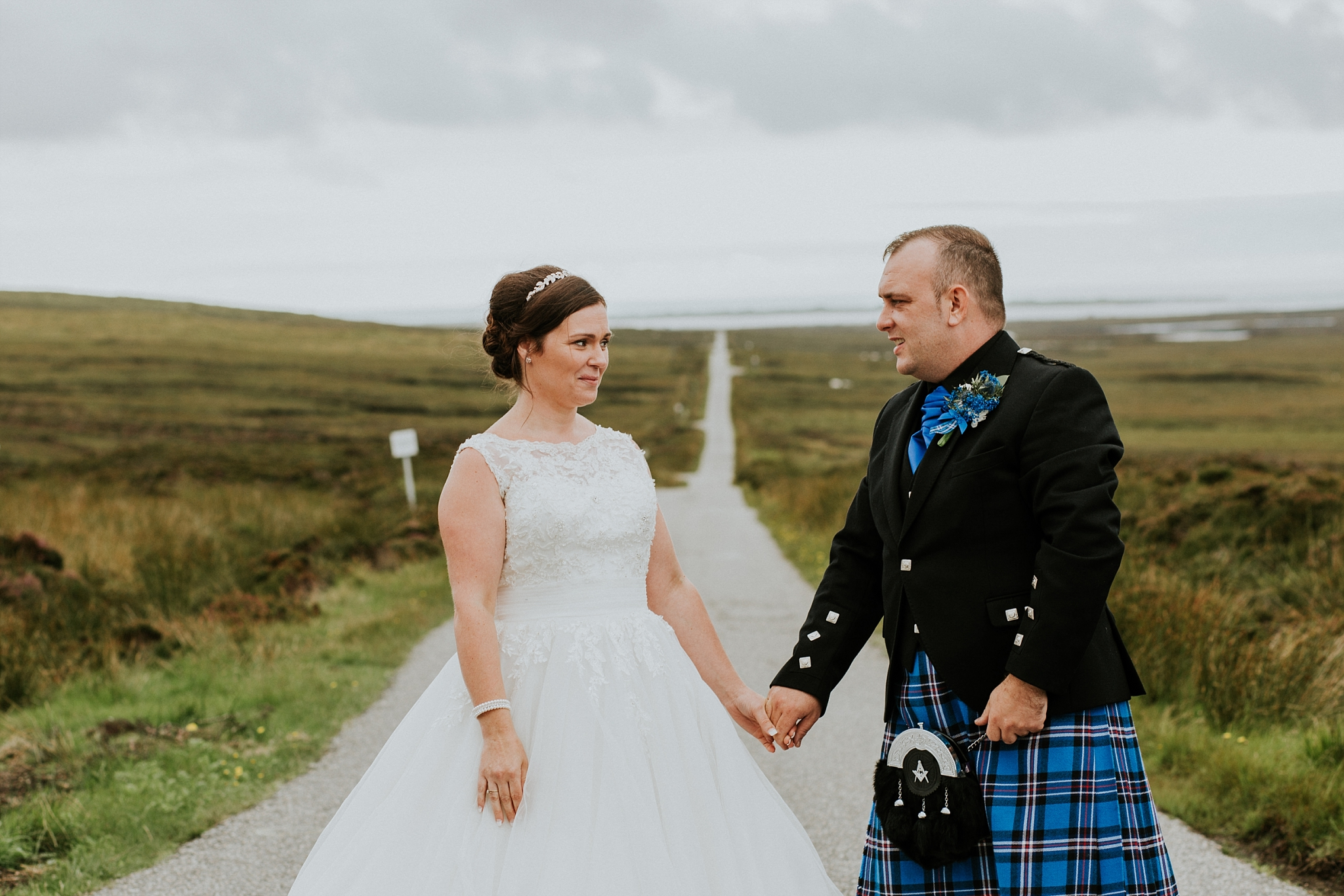 bride and groom looking at each other, solas road, north uist