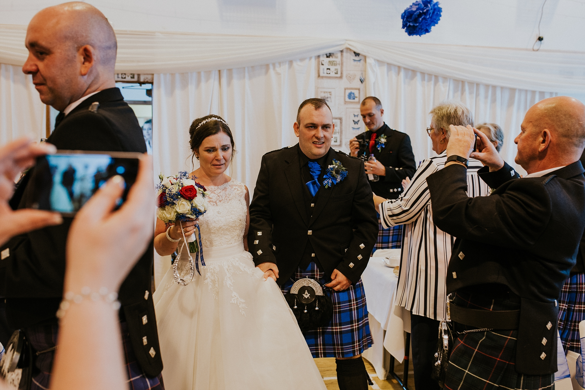 Bride and groom arrive at reception in Carnish Hall, North Uist